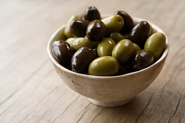 Bowl of olives  olives stock pictures, royalty-free photos & images