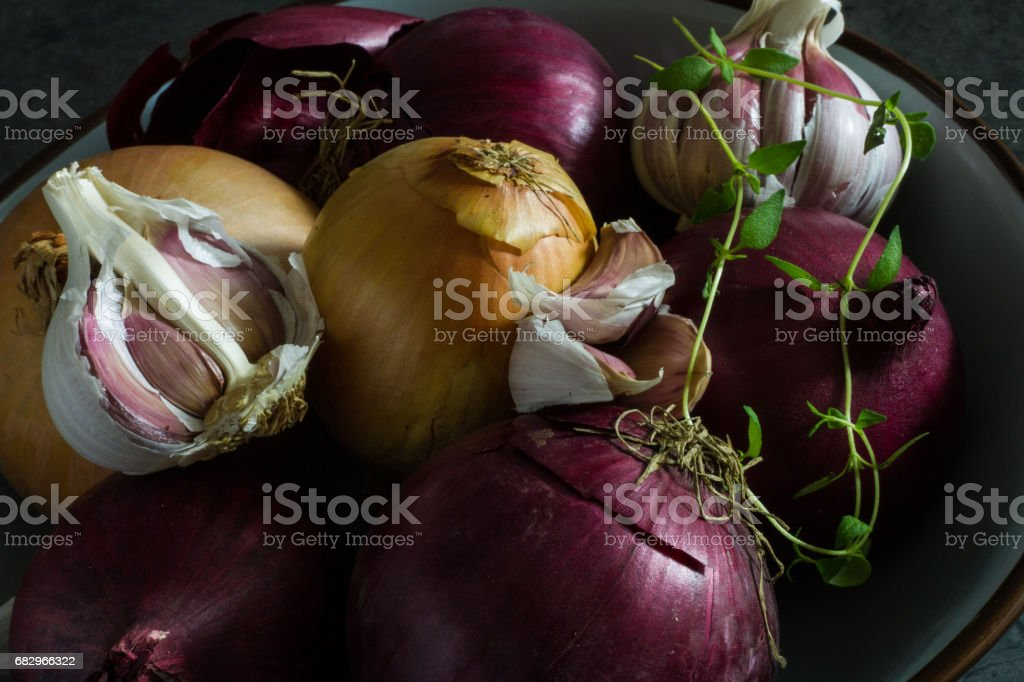 Bowl of onions and garlic royalty-free stock photo