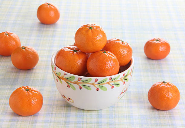 Bowl of oranges on a picnic table stock photo