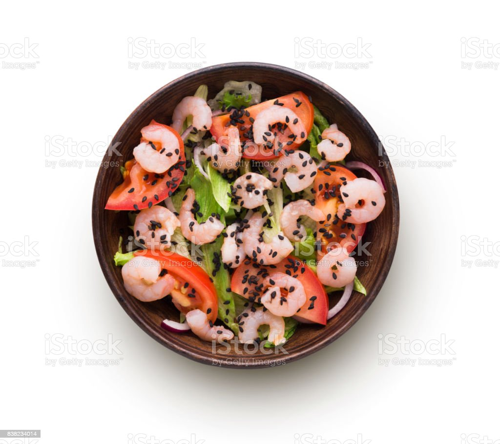 Bowl of original asian salad with shrimps and vegetables isolated at white stock photo