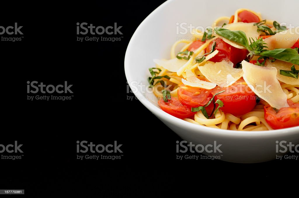 Bowl of pasta against black background royalty-free stock photo