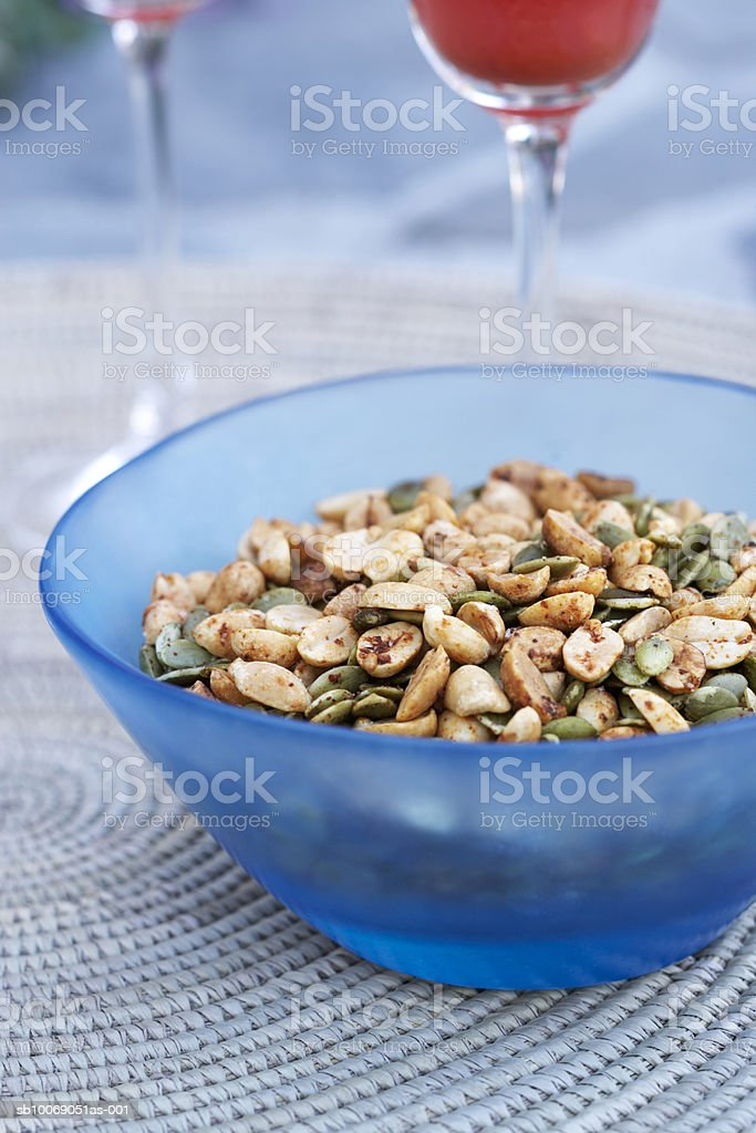Bowl of peanuts, and pumpkin seeds, close-up royalty-free stock photo