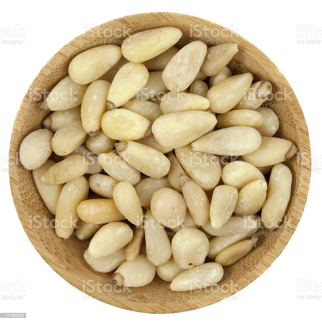 bowl of pine nuts stock photo