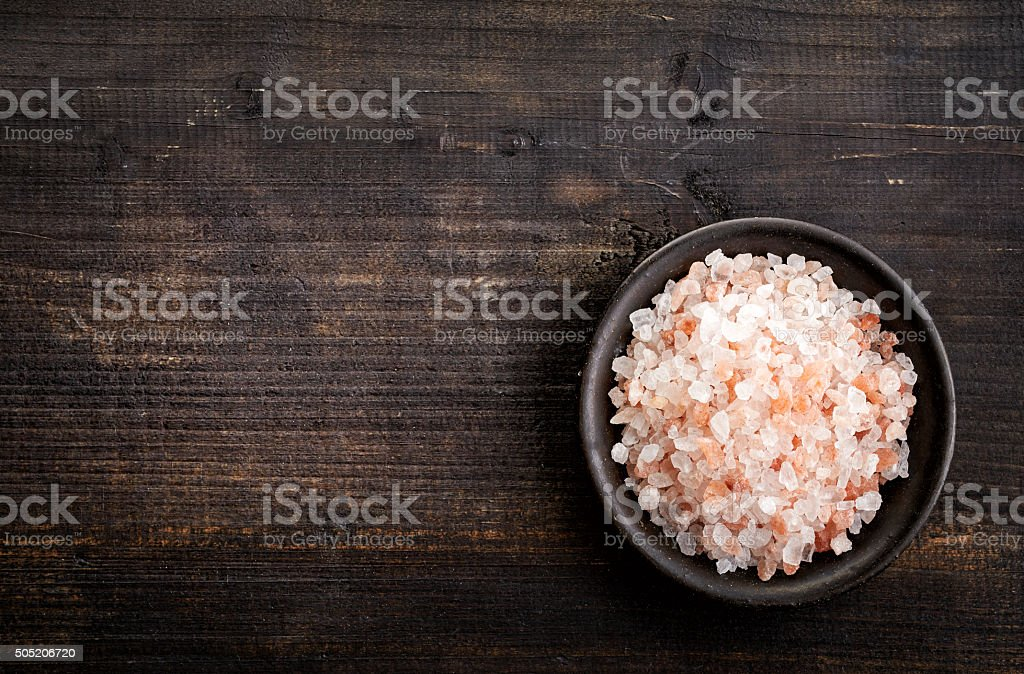 bowl of pink himalayan salt stock photo