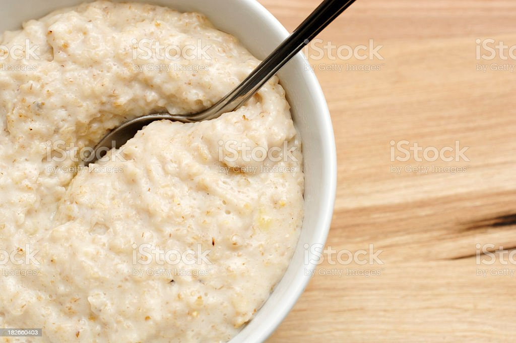 bowl of porridge oats & Sliced Banana, healthy breakfast stock photo