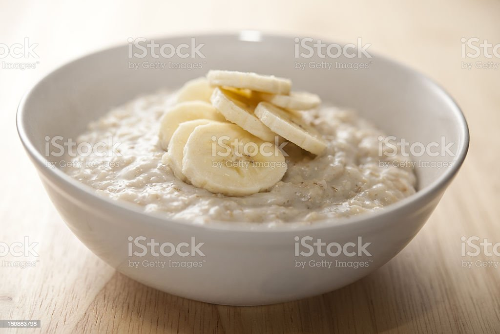 Bowl of porridge with sliced banana stock photo