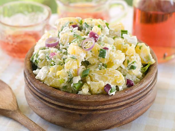 Bowl of potato salad on picnic table stock photo