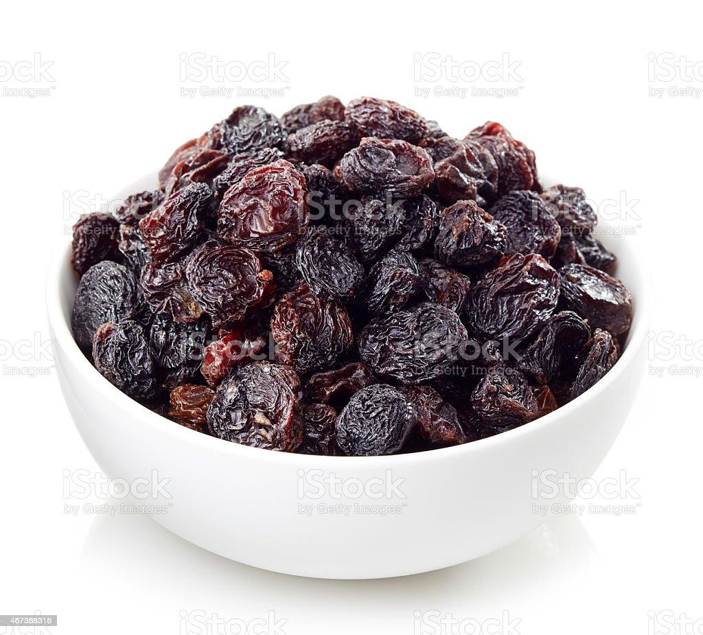 Bowl of raisins Bowl of dark raisins isolated on white background 2015 Stock Photo