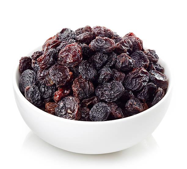 schüssel mit rosinen - grape sugar stock-fotos und bilder