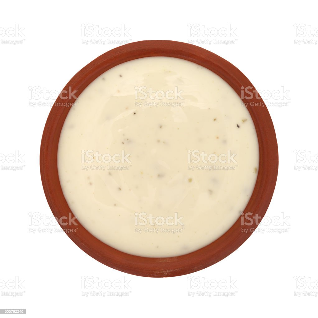 Bowl of ranch dressing on a white background top view stock photo