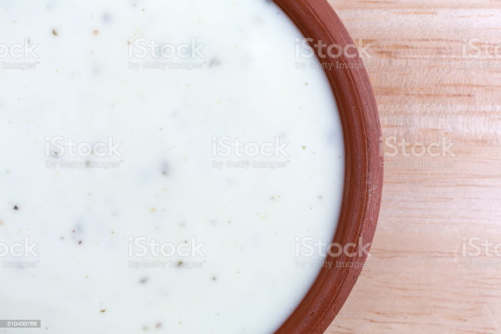 Bowl of ranch dressing on a wood table top stock photo
