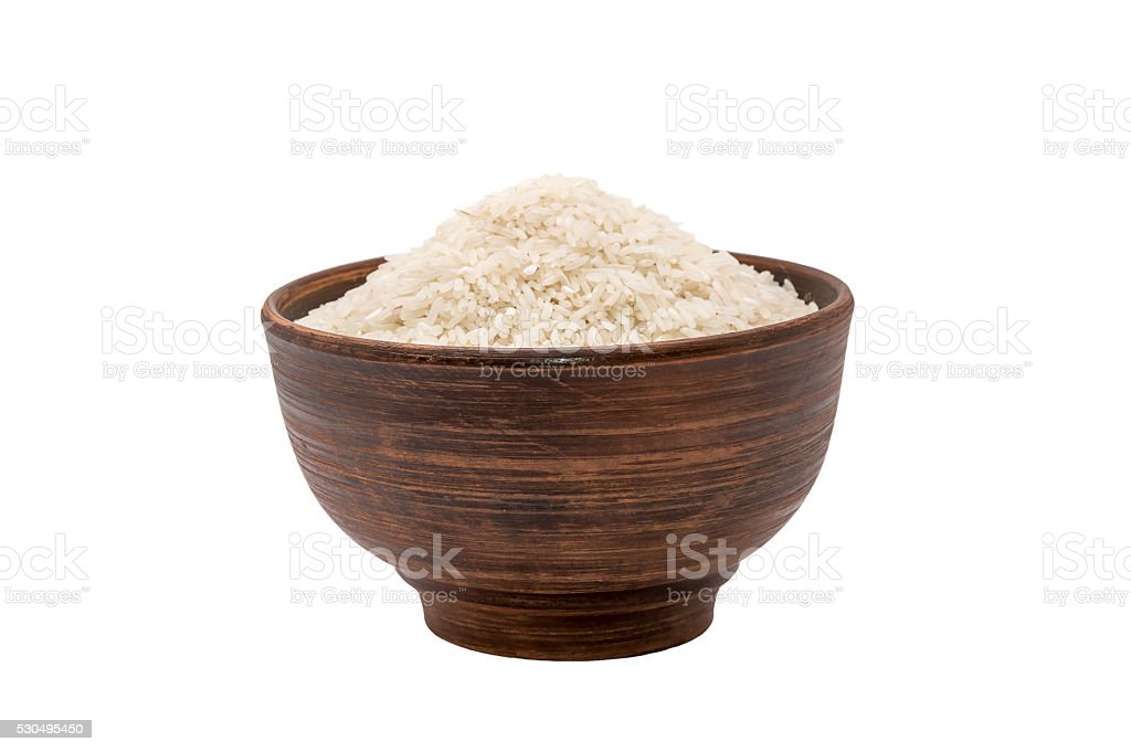 Bowl of raw rice isolated on white stock photo