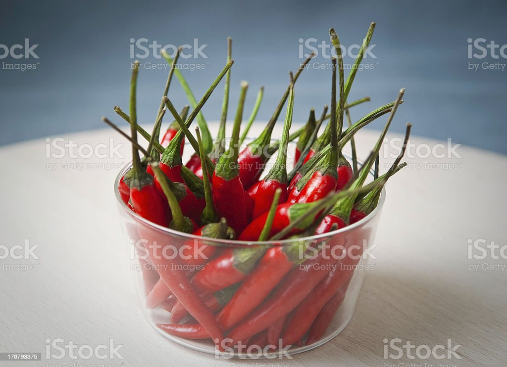 Bowl of red hot chilli peppers. stock photo