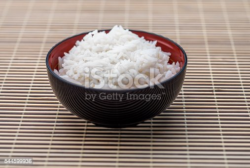 High angle view closeup of a bowl of rice  on bamboo