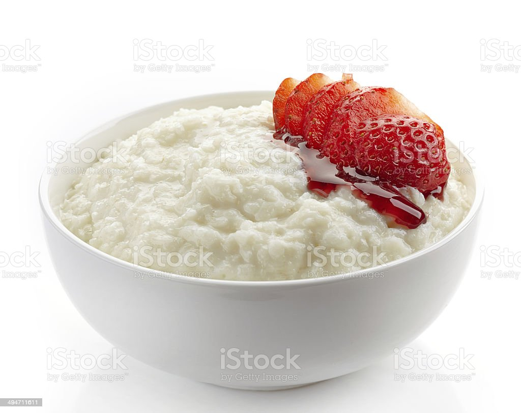 Bowl of rice flakes porridge stock photo