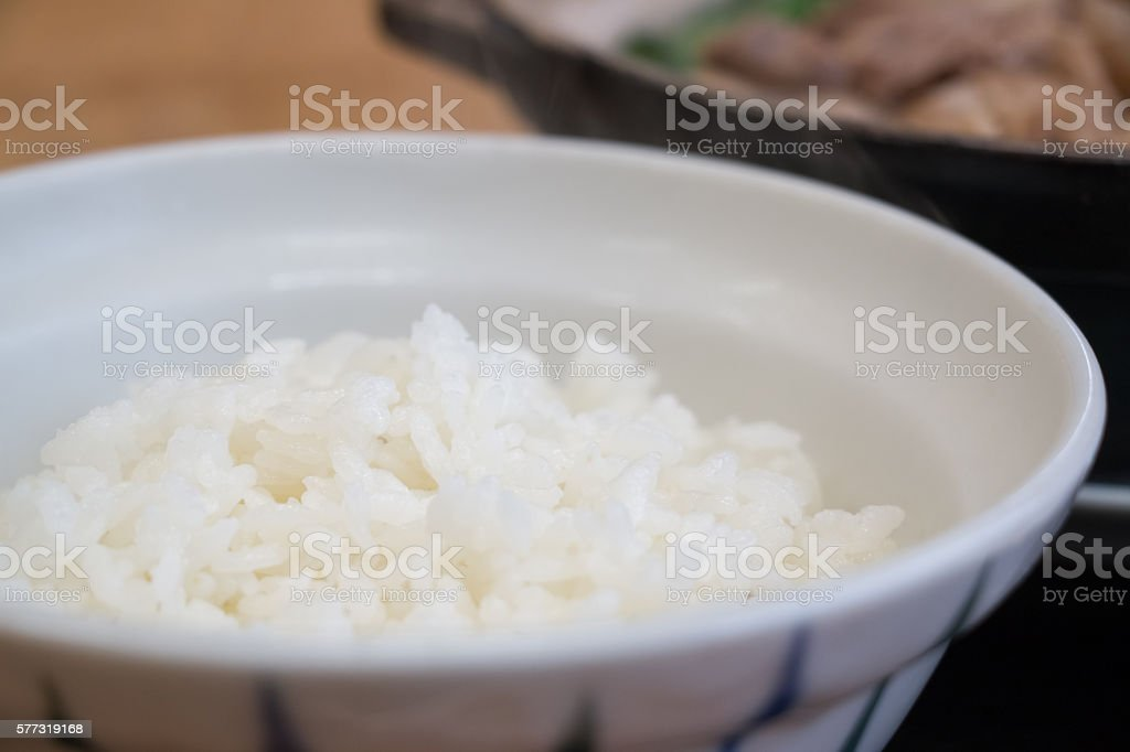Bowl of Rice in Kritanpo nabe set with pork hotpot stock photo