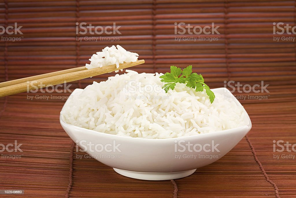 Bowl of rice on mat royalty-free stock photo
