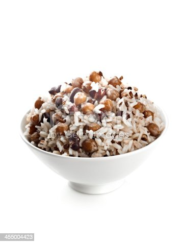 Bowl of Steamed Rice with Beans on White.