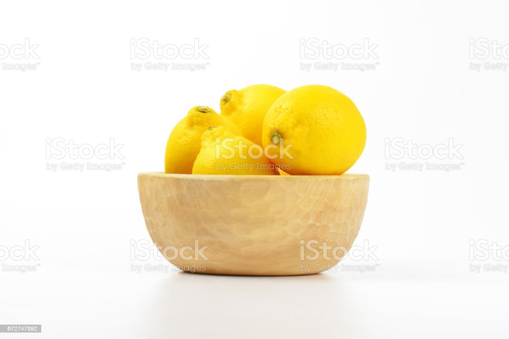 bowl of ripe lemons stock photo