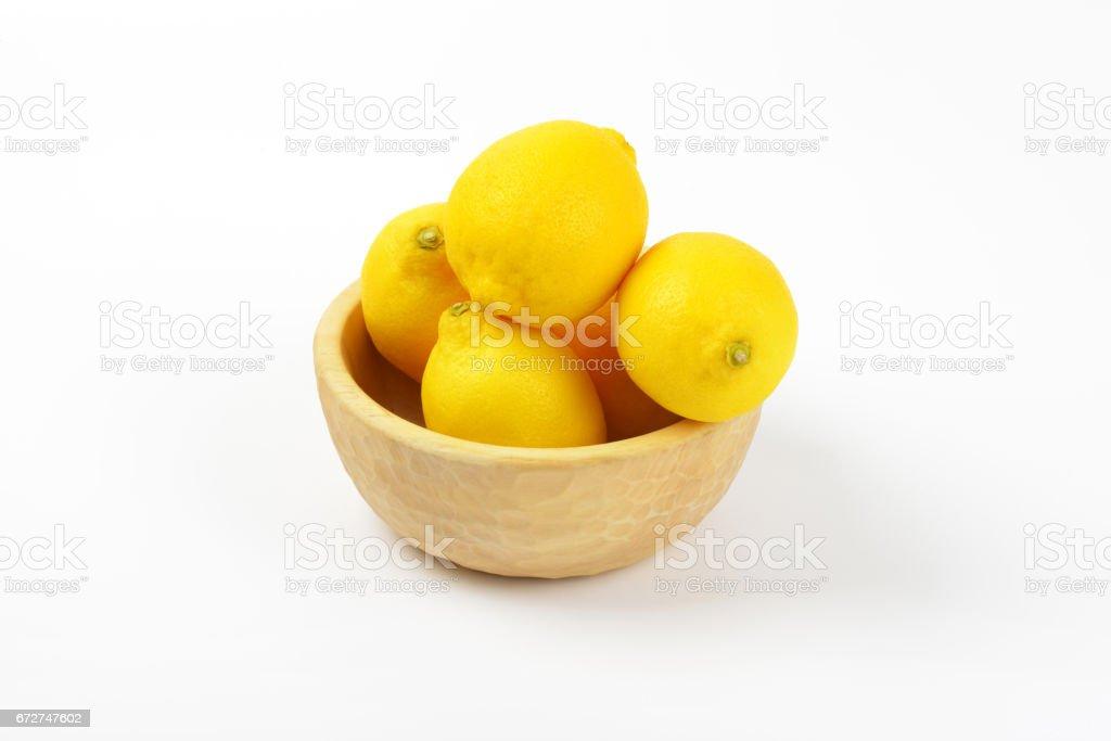 bowl of ripe lemons stock photo