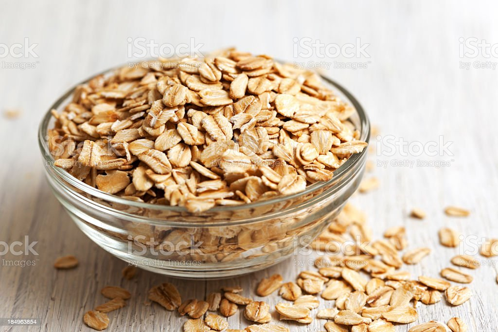 Bowl of rolled oats stock photo