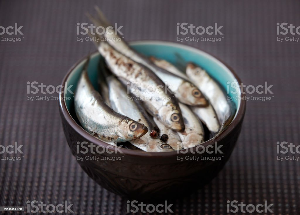 bowl of salted herring stock photo