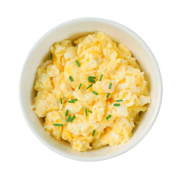 bowl of scrambled eggs stock photo