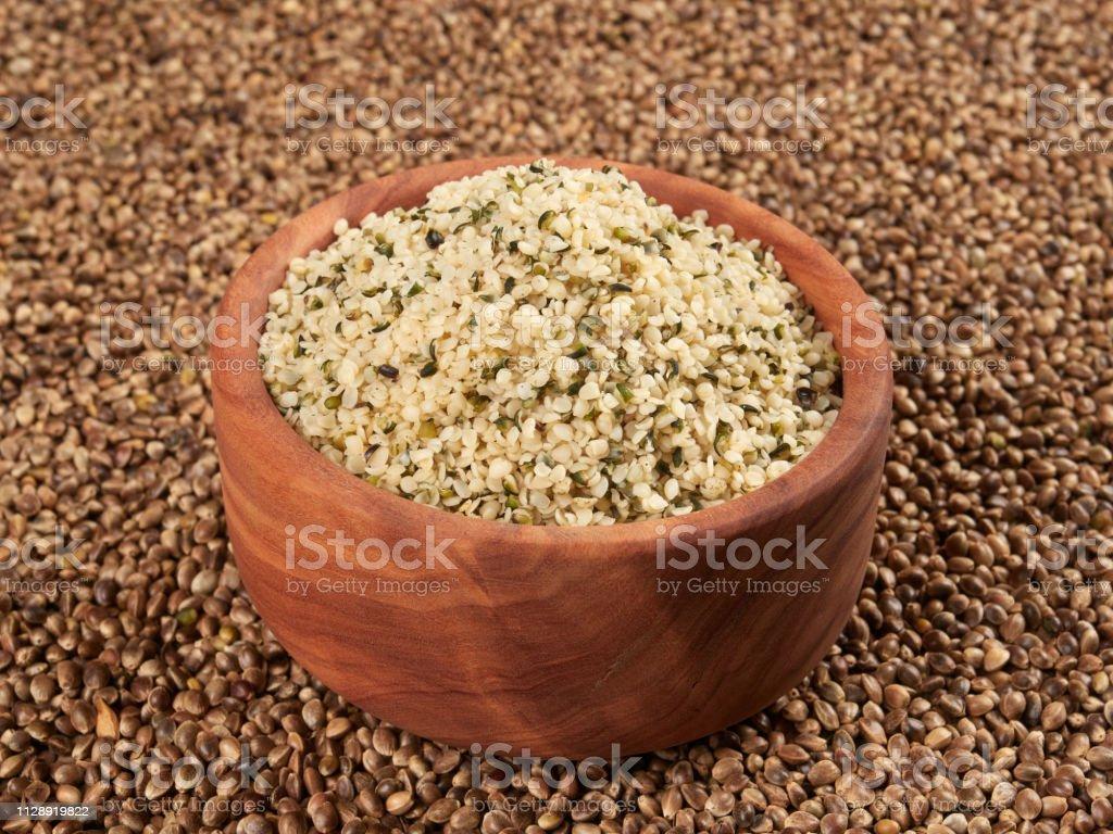 Bowl of shelled hemp seeds stock photo