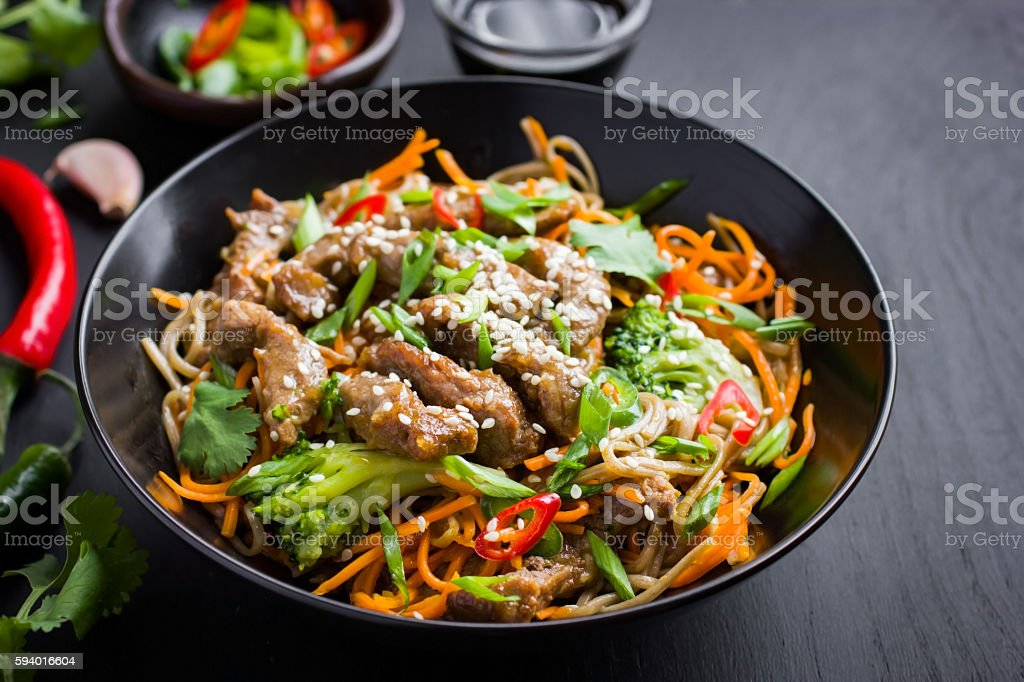 Bowl of soba noodles with beef and vegetables. Asian food. stock photo