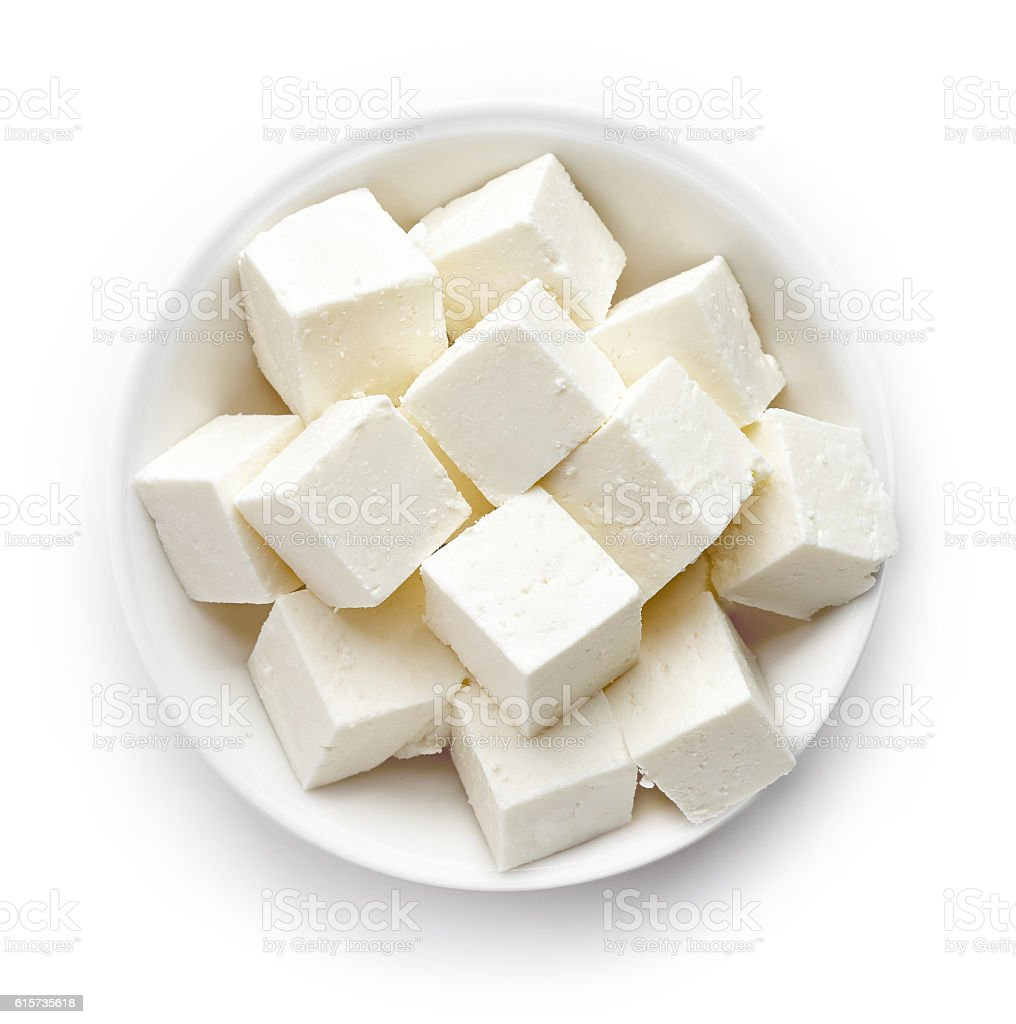Bowl of soft cheese squares from above stock photo