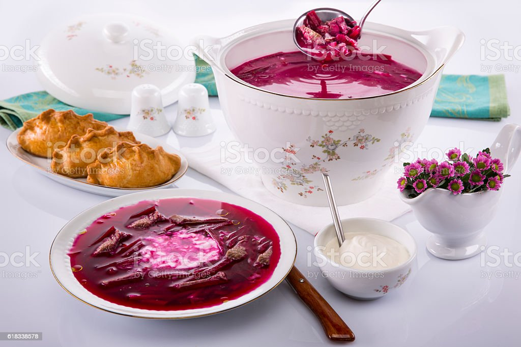 Bowl of soup with beets,sour cream stock photo