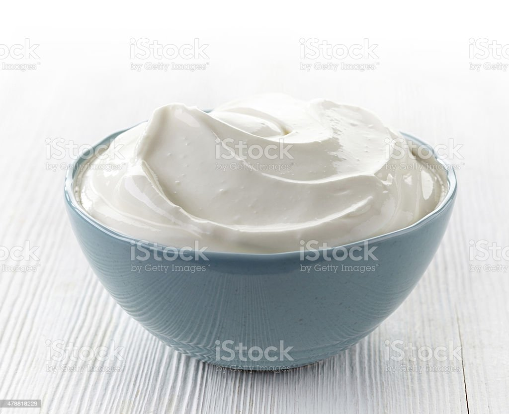 bowl of sour cream stock photo