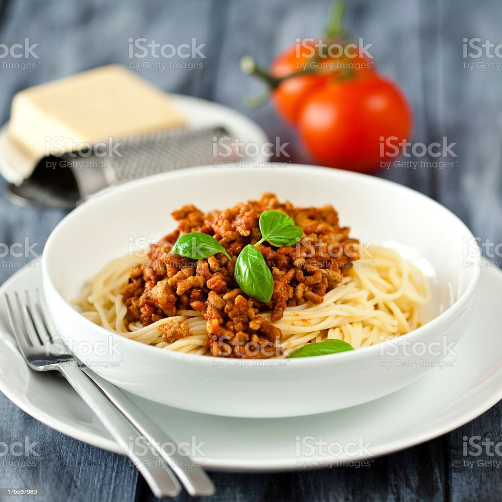 Bowl of spaghetti bolognese with fresh ingredients stock photo