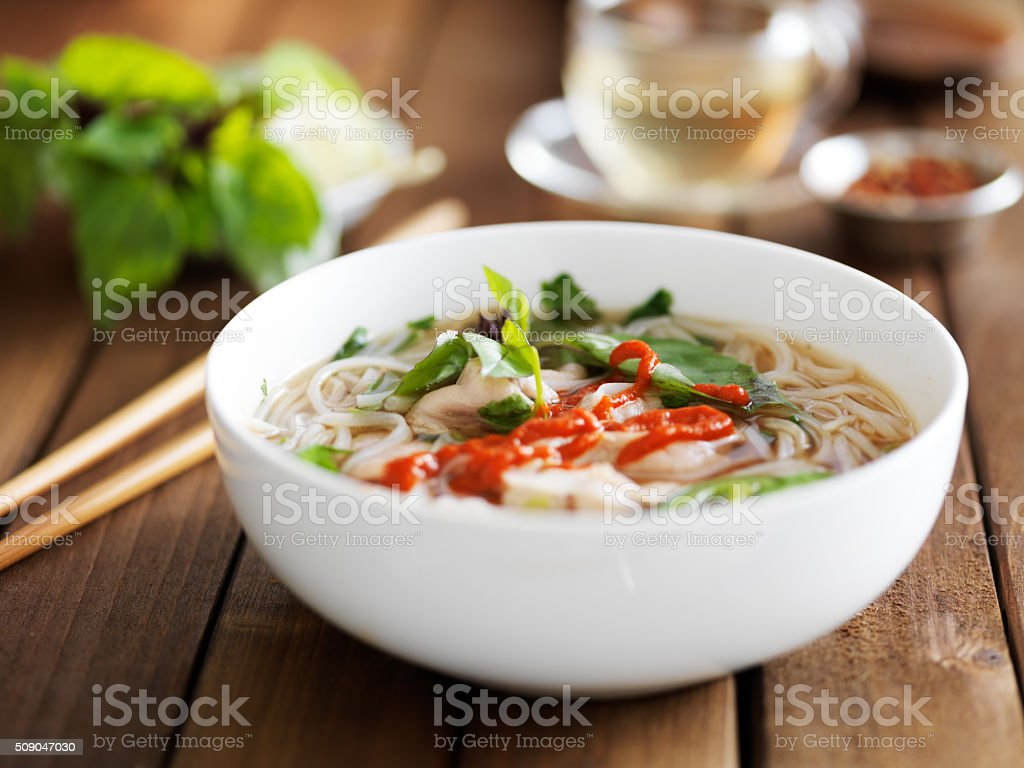 bowl of spicy vietnamese beef pho stock photo