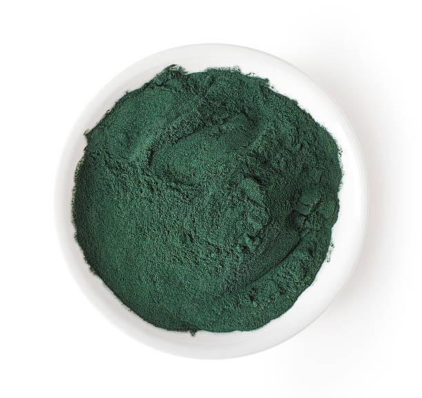 bowl of spirulina powder isolated on white, from above - spirulinabakterie bildbanksfoton och bilder