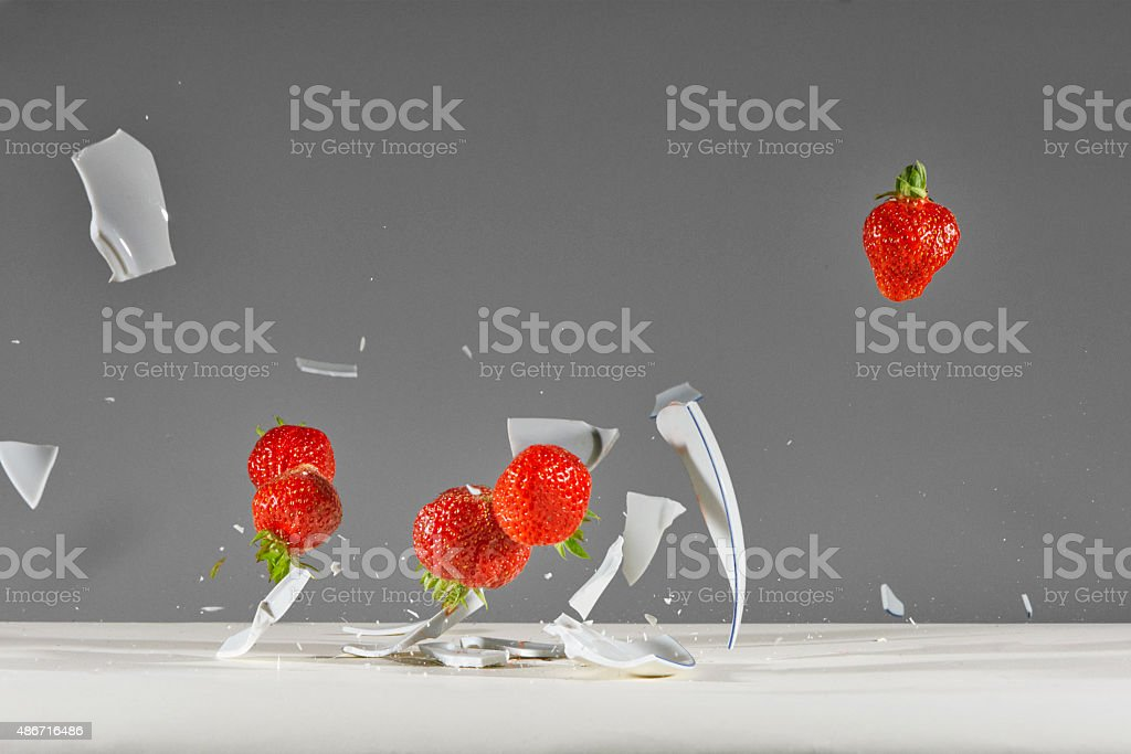 Bowl of Strawberries explode stock photo