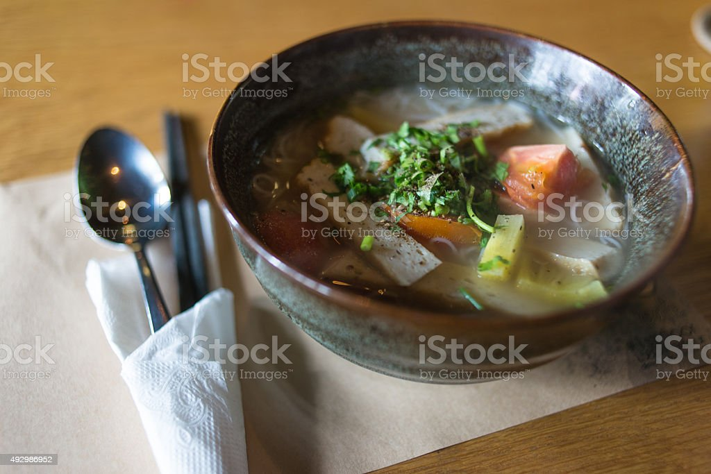 Bowl of Thailand noodle soup eaten with fish-sauce stock photo