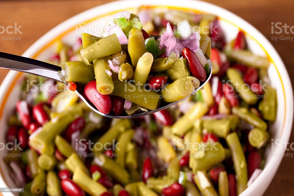 Bowl of three bean salad and ingredients. Food preparation. stock photo