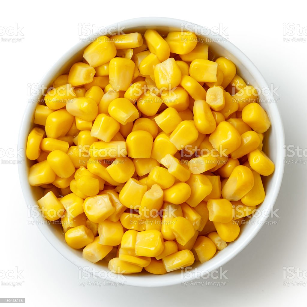 Bowl of tinned sweetcorn isolated from above on white. stock photo