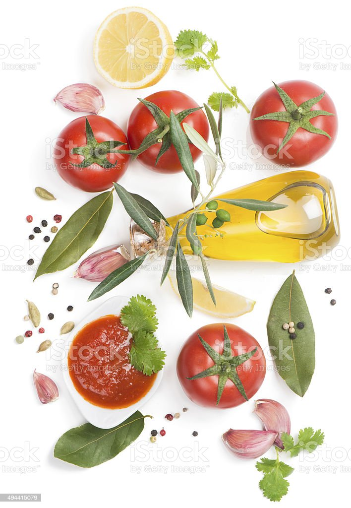 Bowl of tomato sauce with fresh ingredients stock photo