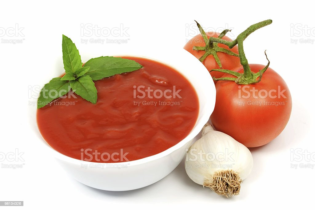 Bowl of tomato soup with garlic and tomatoes royalty-free stock photo