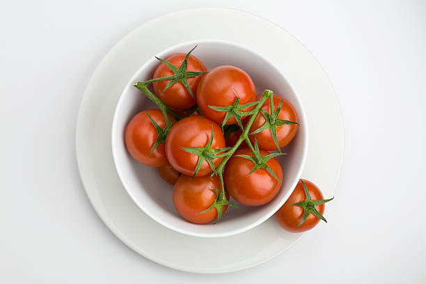 Bowl of tomatoes stock photo