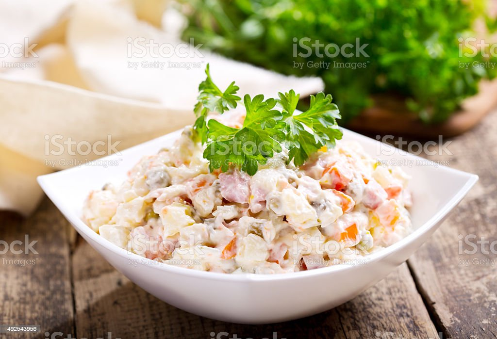bowl of traditional russian salad stock photo