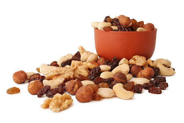 bowl of trail mix with more trail mix in front  - dried fruit stock photos and pictures