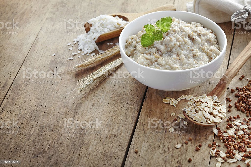 Bowl of various flakes porridge stock photo