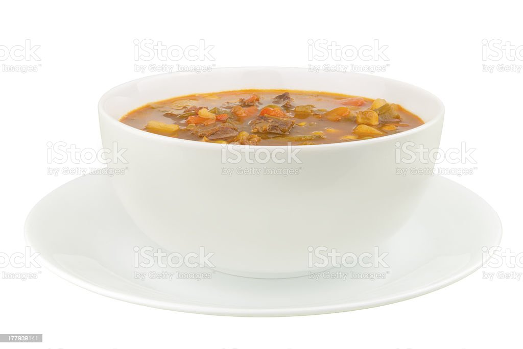 Bowl of Vegetable Beef Soup on a White Background stock photo