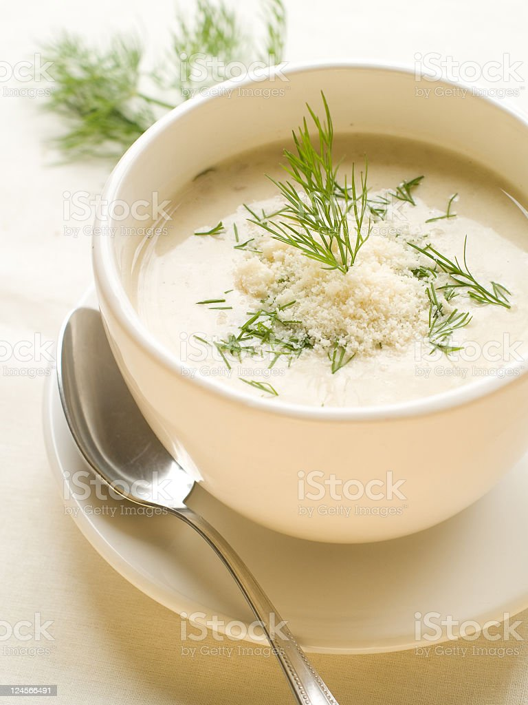 Bowl of vegetable soup on a plate with a spoon royalty-free stock photo