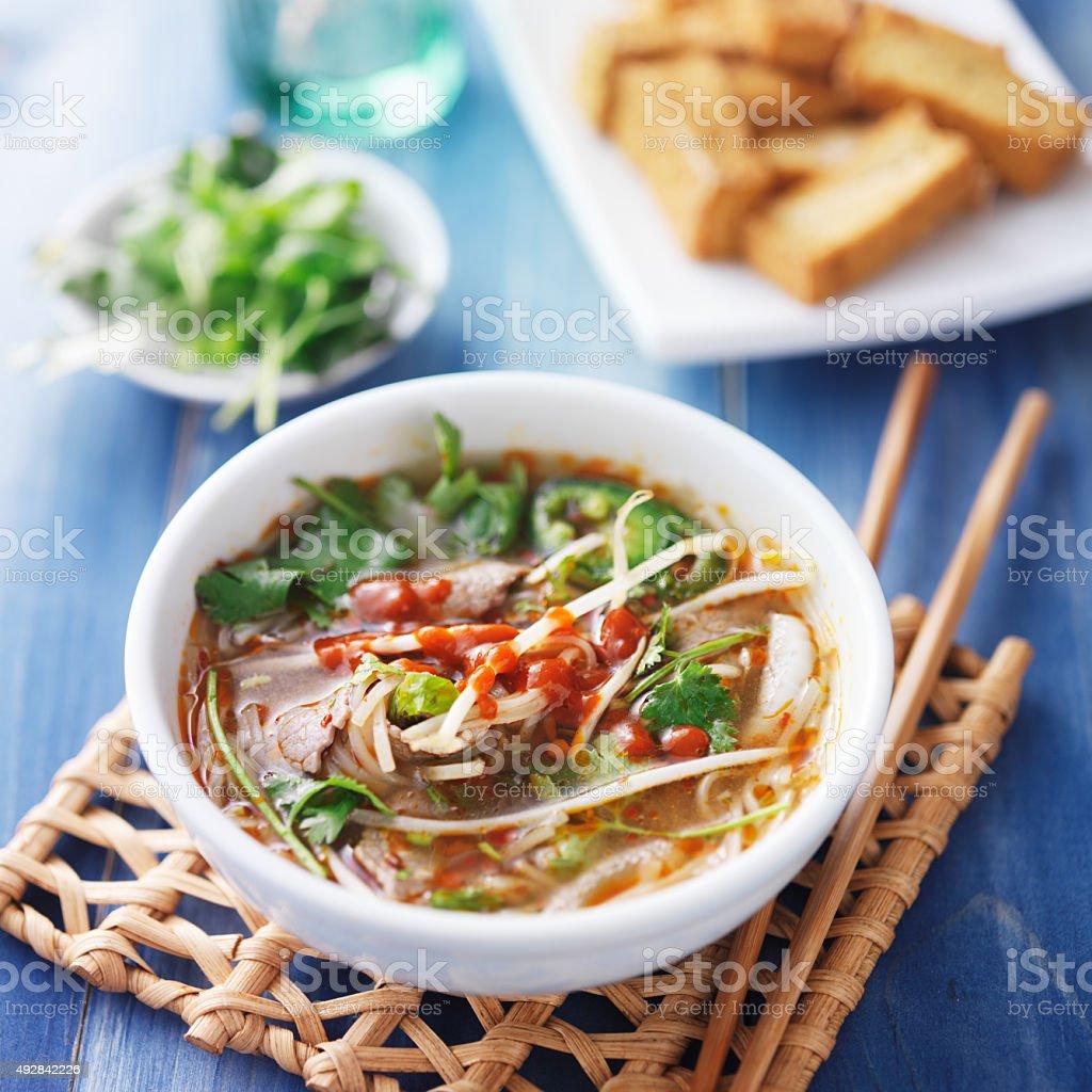 bowl of vietnamese Pho Tai beef soup stock photo