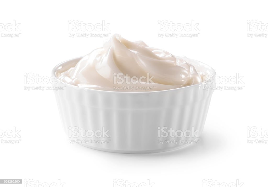 bowl of whipped cream close-up isolated on white stock photo