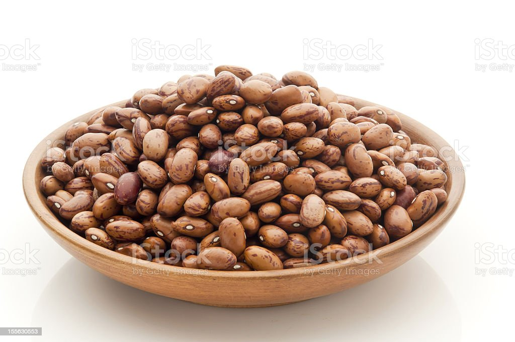 bowl of wood with pinto beans stock photo